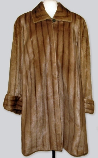 A lush thigh-length fur coat made from sea otter pelt, manufactured by the now defunct Dayton Company in Minneapolis, Minnesota.