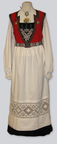 Traditional Norwegian white dress with stylized red breast, made using a unique seam stitch only used in the village of Hardanger, called the Hardangersøm.