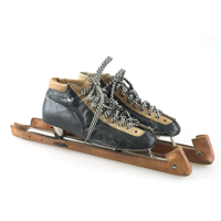 A pair of black leather speed skates with brown leather skate guards and striped black and white laces owned by medalist Glen Skibstad.