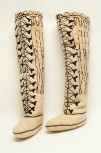 Traditional Inuit wool tall boot linings with symmetrically embroidered shapes along the side and faux black lacing created by artist Jessie Oonark.