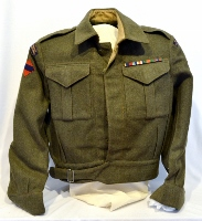 Green khaki wool uniform jacket with rank insignia and commendations, originally belonging to Harold Clement.