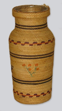 A tightly woven tall cedar basket in style of the coastal British Columbia Nuu Chah Nulth people. The weave is so skillfully compact that it is nearly waterproof.