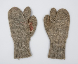 Roughly woven grey wool mittens with separate index finger, designed for East Coast fisherman to grip lines while keeping their hands warm.