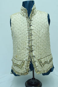 Silk waistcoat adorned with false pockets, floral trim, and steel beads, denoting the high status of its owner Robert Hamilton.
