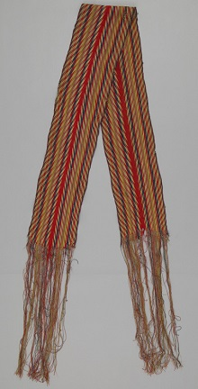 A red, blue, white, yellow and green finger woven ceinture fléchée woven in an arrowhead pattern.