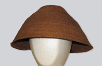 A woven brown cedar hat made in the traditional style of the Tsawwassen First Nation with brim finished with a twisting twine.