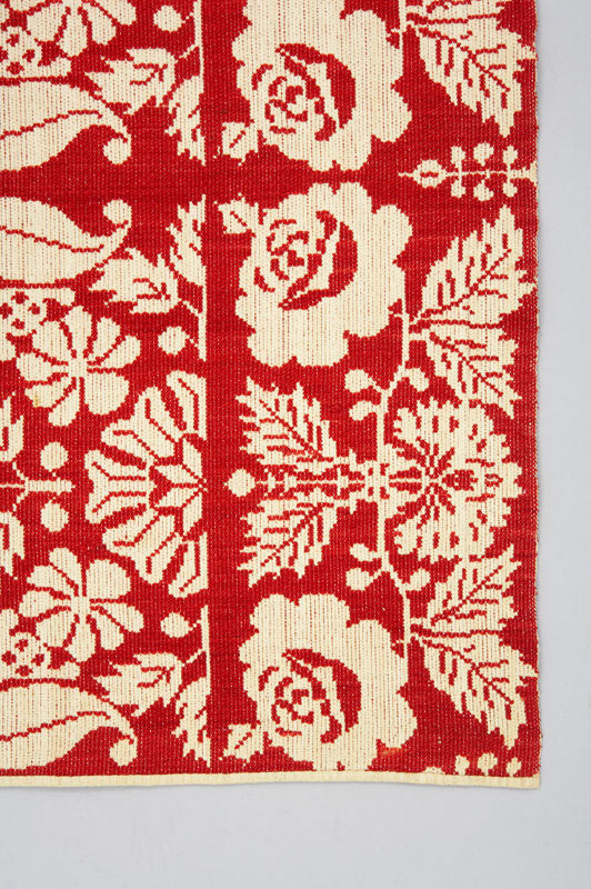 Rear detail of red and white rose border on this coverlet.