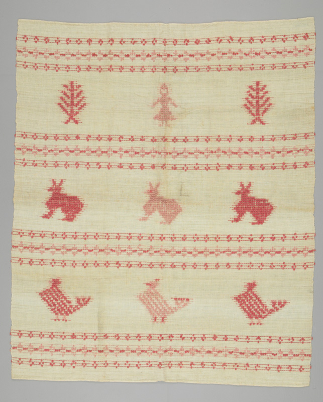 Red and white coverlet with three horizontal rows featuring a girl and two pines, three chickens and three rabbits.