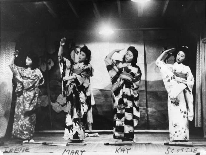 Four women in kimonos on a stage with names written on the photograph: Irene, Mary, Kay and Scottie.