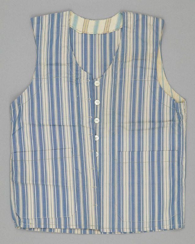 A humble button-up vest made from vertically striped blue and white fabric with two large pockets on the front.