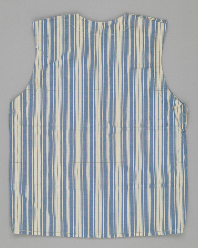 Rear view of a button-up vest made from vertically striped blue and white fabric.
