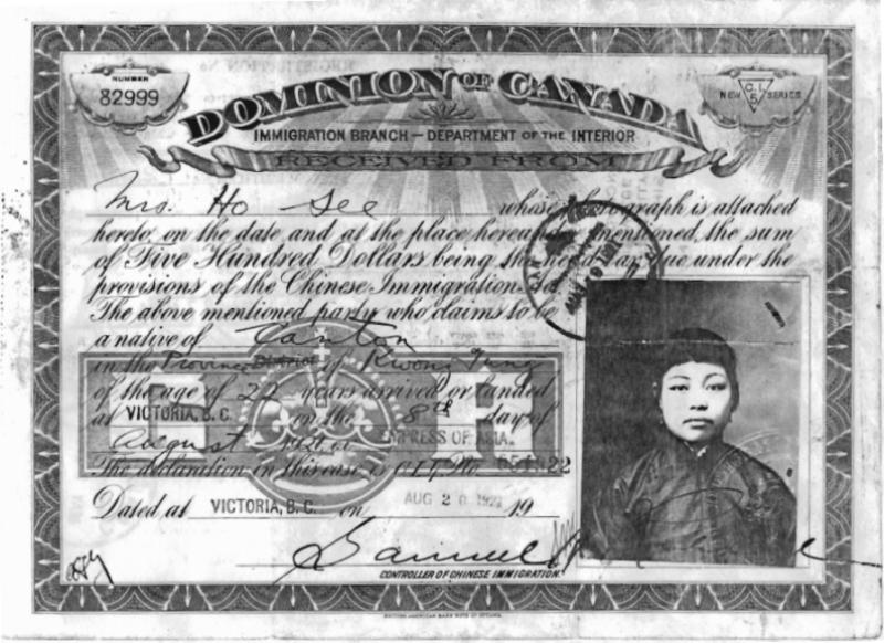 A stamped immigration certificate made out to <abbr title='Missus'>Mrs.</abbr> Ho See with a photograph of a young, unsmiling <abbr title='Missus'>Mrs.</abbr> See attached.