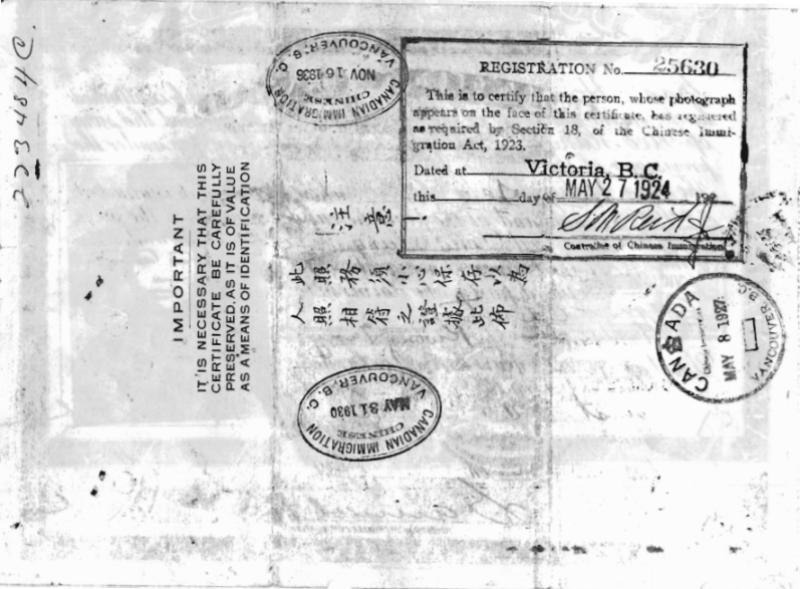 Rear of stamped immigration certificate made out to <abbr title='Missus'>Mrs.</abbr> Ho See.