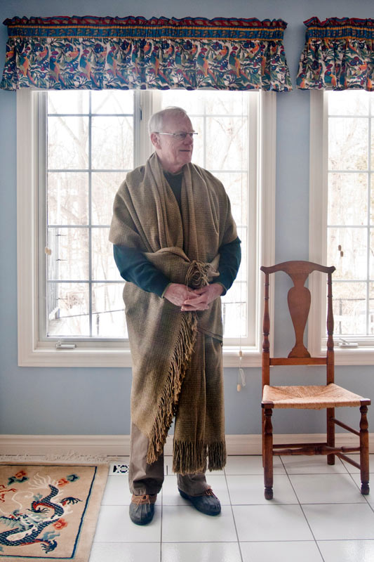 Jim Green draped in a similar shawl, standing in front of a window with his hands folded at his waist.