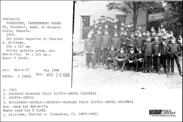 Toronto Public Library catalogue card with an image of the Independent Order of Foresters band posing in front the Hotel Columbia.