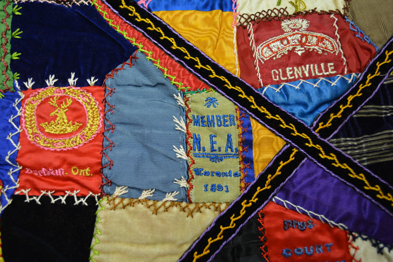 Detail of the quilt showing the variety in ribbons, stitching techniques, and thread colours.