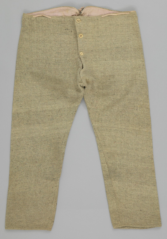 Natural coloured wool long underwear with three buttons, visible waist drawstring and pink lining at the waist.