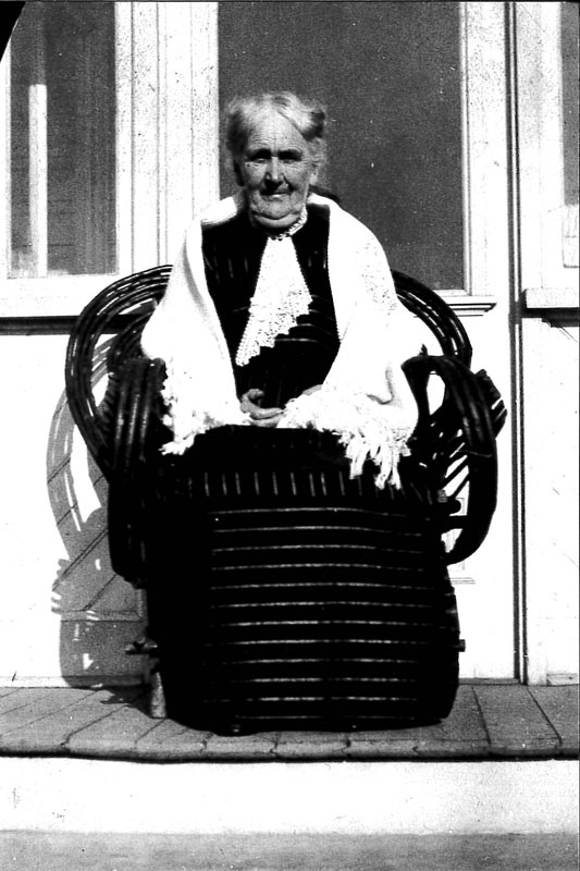An elderly Janet McIntyre Ferguson poses for a portrait while seated on the porch of her home in North Bay, Ontario.