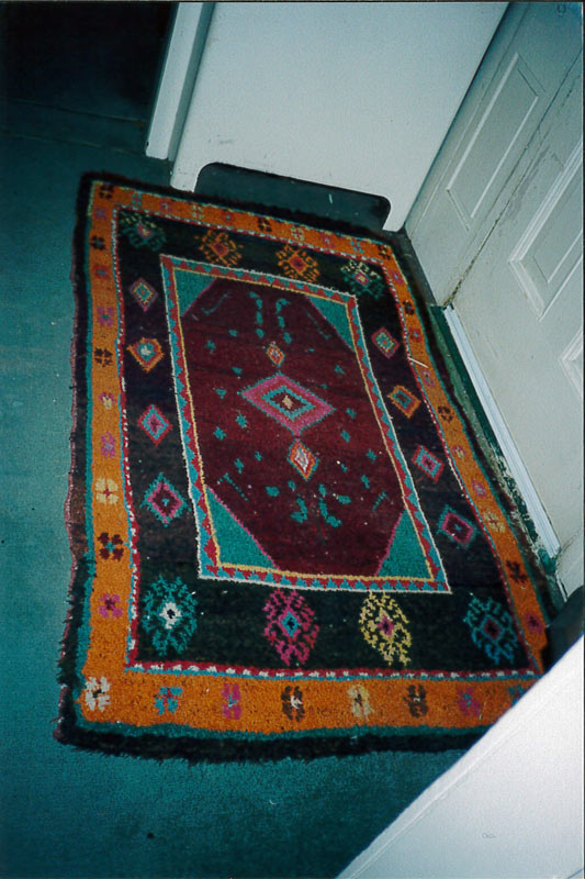 A traditional Doukhobor style rug in regular use in a doorway of the home of Janet McIntyre Ferguson.