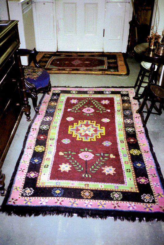 Traditional Doukhobor style rugs in regular use in doorway and hallways of the home of Janet McIntyre Ferguson.