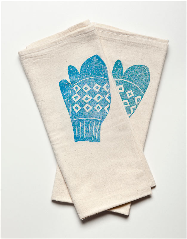 White napkins imprinted with the image of bright blue trigger mittens made by Renee Scott, Newfoundland, 2012.