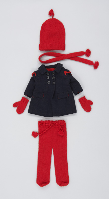A small handmade doll's winter outfit made of dark blue wool and red wool for the toque, mittens, scarf and pants.