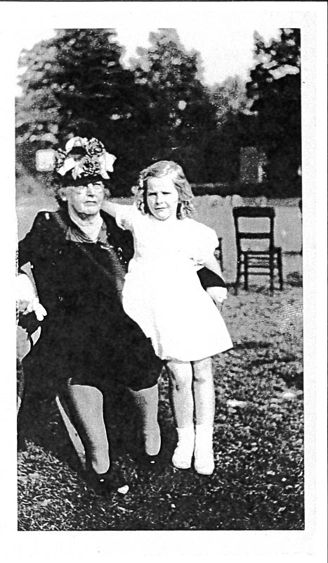 Posed outdoor portrait of a woman and young girl, Anna McLeod Gilmor and granddaughter Margaret, late 1940s.