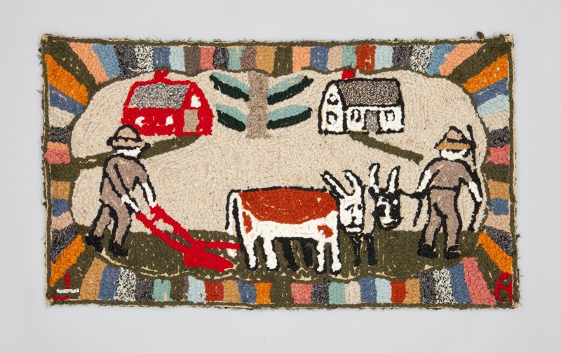 Rear view of a burlap and wool hooked rug depicting life on a rural farm, goats stand while a farmer pushes a bright red till in the foreground.
