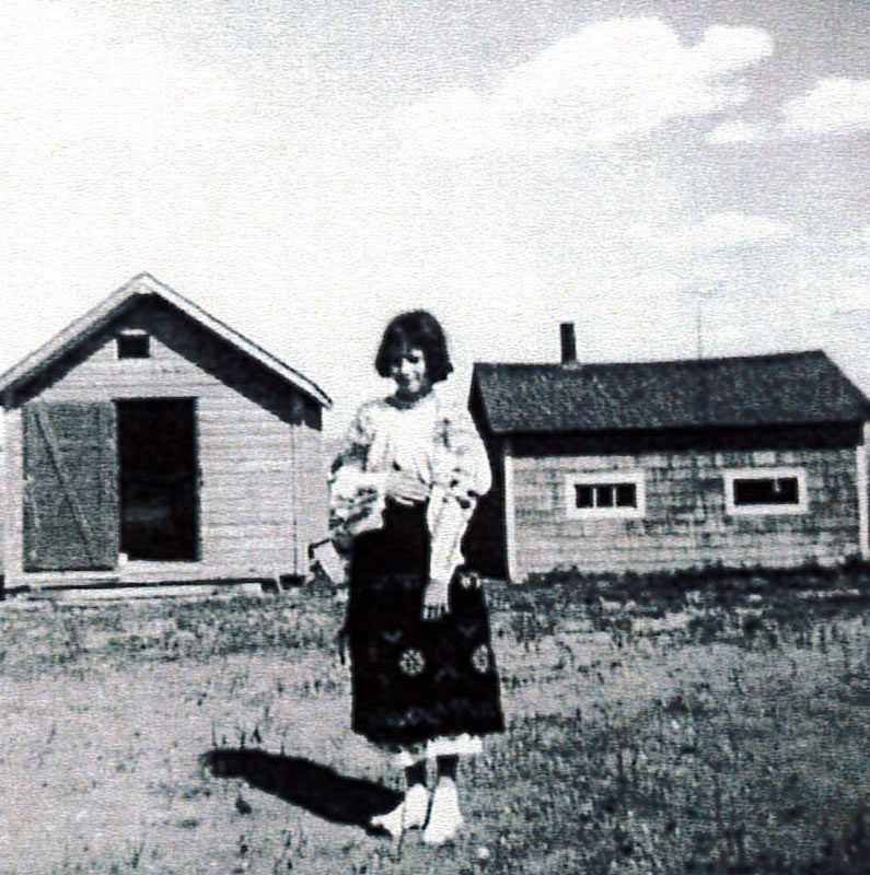 A young girl, Genevieve Gordon, granddaughter of the maker of the blouse, on a farm in Saskatchewan, 1960.