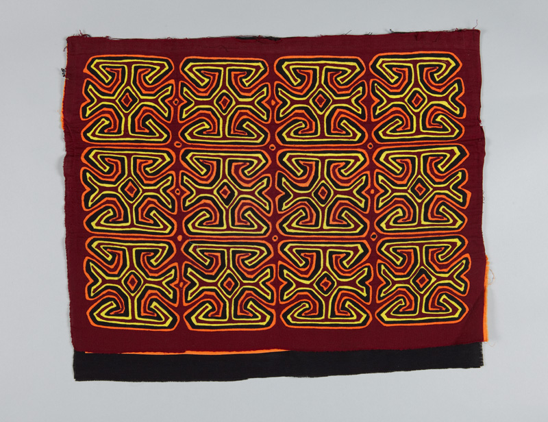 A rectangular cotton appliqued blouse panel known as a mola. Bright yellow and orange designs repeat in rows against a red background.