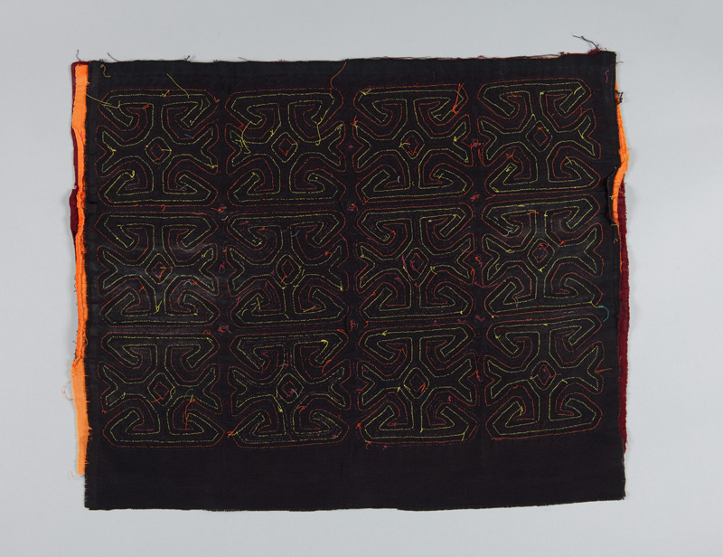 Rear view of a rectangular cotton appliqued blouse panel known as a mola, showing the dark blue cotton backing and hand stitching of each design.