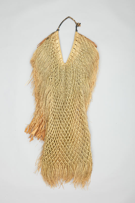 Inside view of Japanese rain cape made from twisted and knotted linden tree bark, seaweed, grass, and cotton fabric, showing inner knotted net construction.