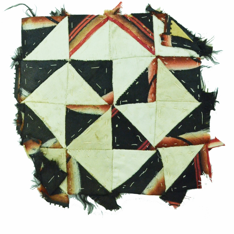 Another small patchwork of dark coloured interlocking triangles made during the crisis in 1837 by Fanny Riley.