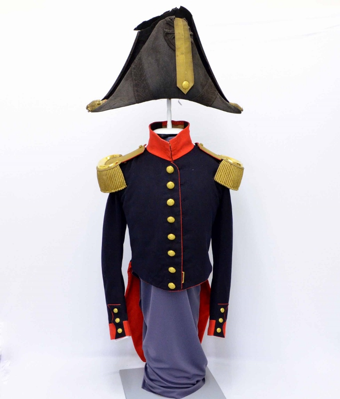 Dark navy uniform with golden buttons and epaulets, paired with dark bicorn hat, originally worn by William Duff in the 1830s.