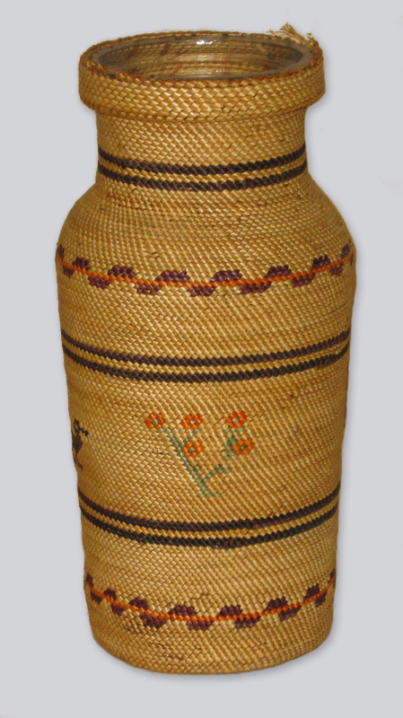 A tightly woven tall cedar basket in style of the coastal British Columbia Nuu Chah Nulth people.