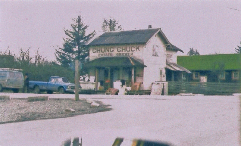 Historic photo of the two storey white walled 'Chung Chuck Potato Grower' store in Ladner, British Columbia.