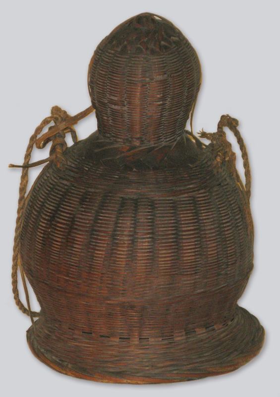 A woven rattan wicker jug created by shaping the material around a hard shell gourd, in traditional Chinese style.