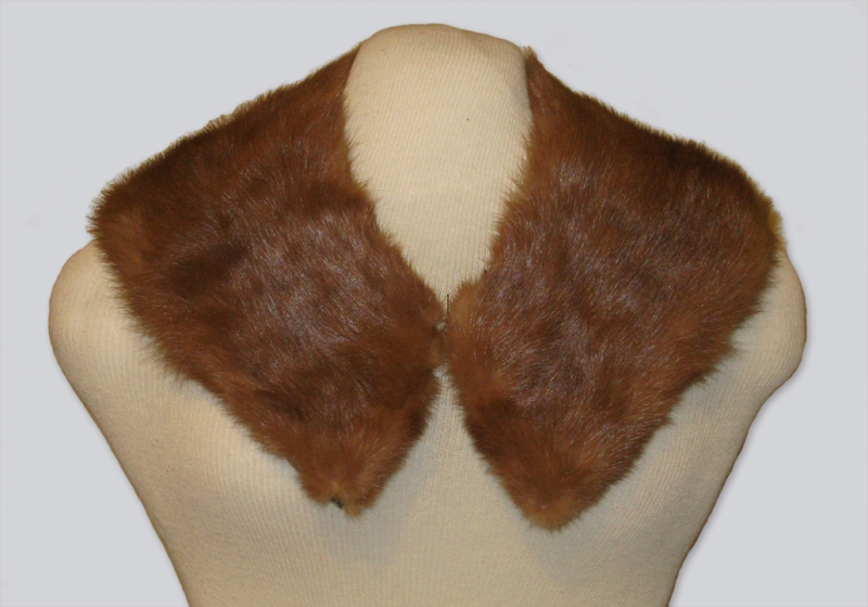 A lush brown mink collar designed for women's clothing, dating to the 1950s. The finished pelt hangs from the neck to the shoulders.