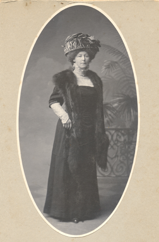 Posed historical portrait of Elizabeth Burr wearing a long fur stole and other fine clothes in New Westminster, British Columbia.