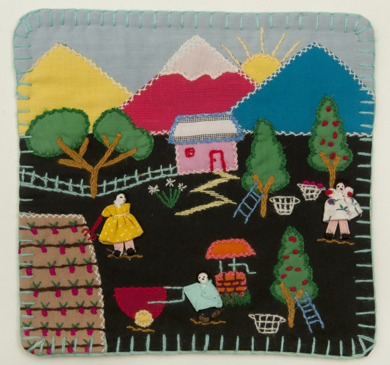 A traditional Chilean arpillera composed of a colourful rural scene appliquéd and embroidered onto a rectangular burlap backing.