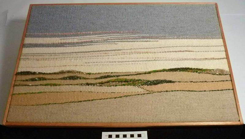 Woven landscape artwork by Elaine Rounds titled 'August Horizons' depicting a prairie landscape with rolling fields.