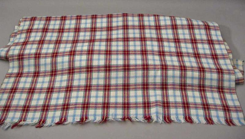 A red and white version of the Manitoba tartan by the same designer, reserved for formal dress occasions.