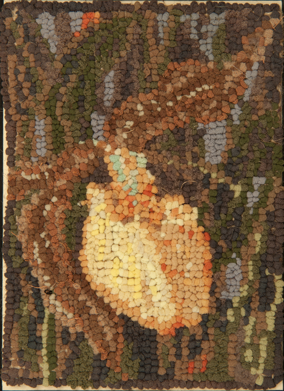 A rug hooking depicting of a rare a yellow lady's slipper flower, an excellent example of artist Delza Longman's signature hooking style.