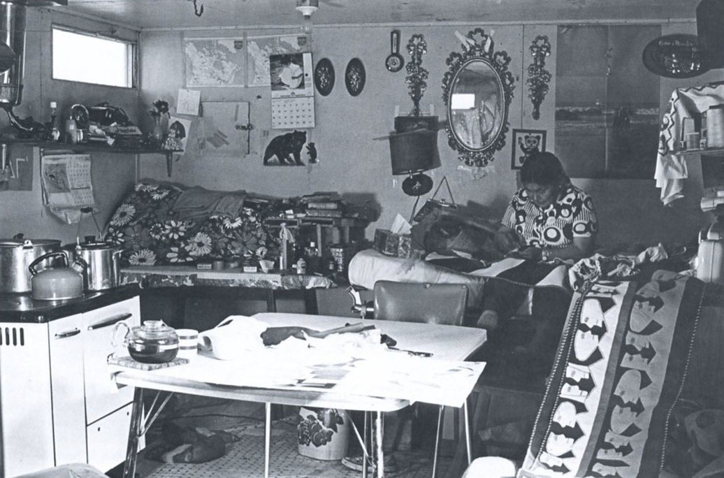 Artist Jessie Oonark in her home and workshop 1983 surrounded by a number of works in progress.