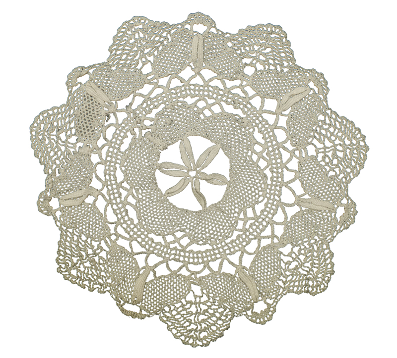 A lace doily worked in a variety of techniques with needle woven butterflies, their wings made using a needle lace technique.
