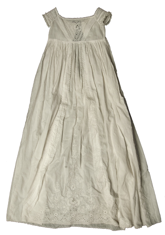 White 19th century christening gown with Ayrshire embroidery, delicate floral patterns stitched on fine muslin among other techniques.