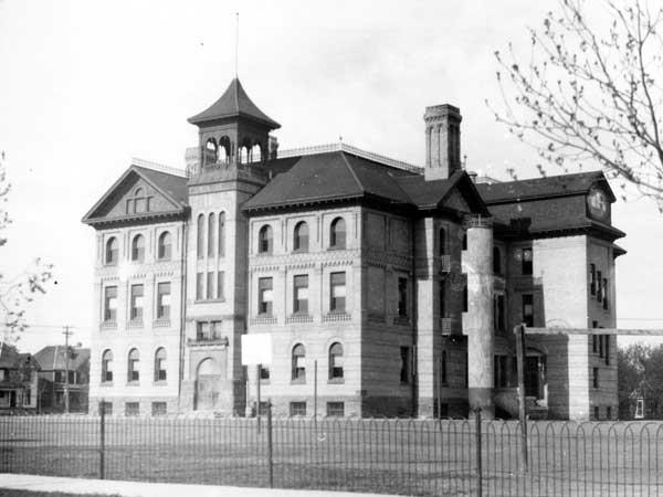 Historic photo of the large three-story Mulvey School in Winnipeg, Manitoba as it appeared in 1939.