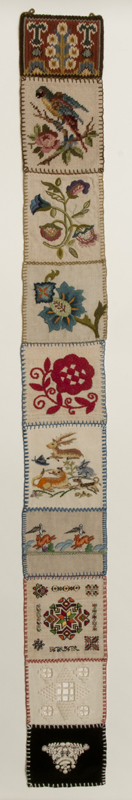 Cloth rectangular bell pull composed of ten squares in a different style of needlework representing the diverse ethnic groups active in the early guild.