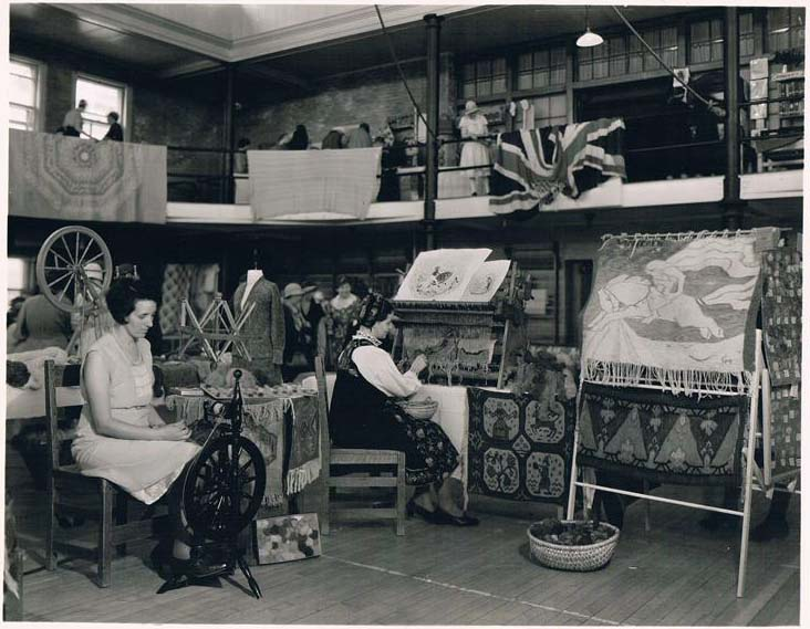 Women demonstrating spinning and weaving at the Manitoba Agricultural College in 1933.