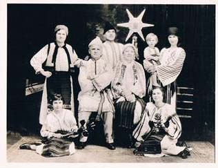 Posed group portrait of the Crafts Guild of Manitoba's Romanian Group in 1933 in traditional costume.